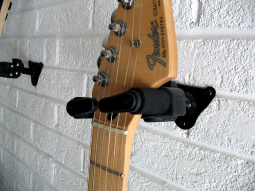 Guitar wall hanger review Swivels to conform to the headstock